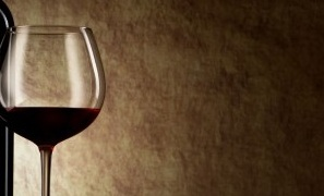 photodune-1930437-bottle-with-red-wine-and-glass-on-a-old-stone-m-300x375
